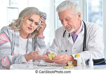 Sick elderly woman in a doctor's office