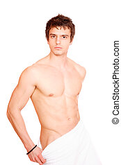Young, handsome man overwraped by towel. Isolated on White...