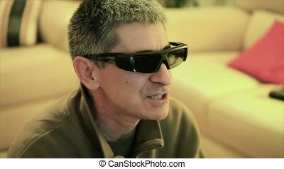 Man Playing 3D Videogame - Caucasian middle aged man...