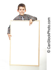 Smiling boy pointing to blank banner