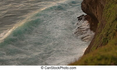 Surf on a rocky shore near Pura Luhur Uluwatu. Bali island...