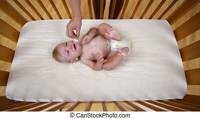 Baby Crying in Crib - Baby crying in crib at home and being...
