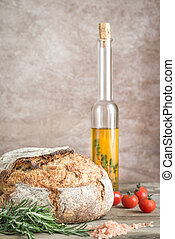 Loaf of wholewheat bread with cherry tomatoes and fresh...