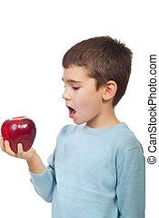 Small boy ready to bite red big apple - Small boy preparing...