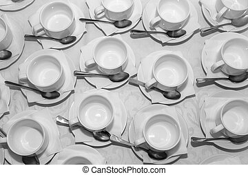 Cups on saucers with spoons