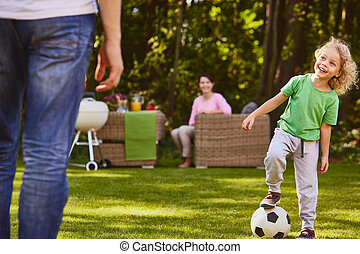 Child playing soccer ball