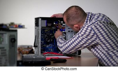 Professional computer service specialist man remove and...