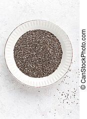 Chia seeds on white baclground directly above copy space