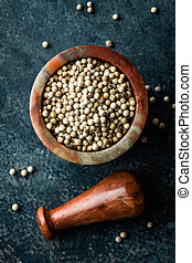 White pepper on dark background directly above copy space
