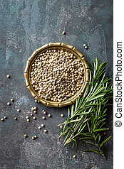White pepper and fresh rosemary twigs, culinary ingredients...