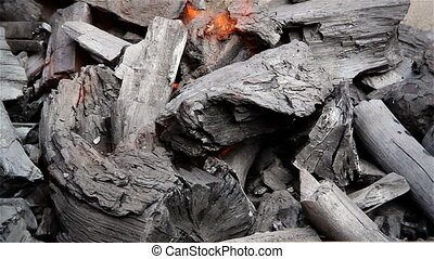 Charcoal flame - Stock footage closeup of mesquite charcoal...