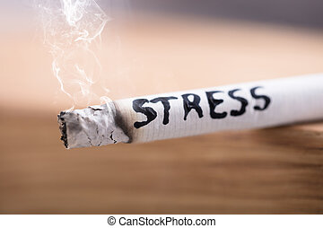 Stress Word On Burning Cigarette - Close-up Of A Stress Word...