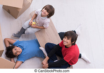 boys with cardboard boxes around them top view