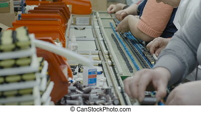 Workers manually assemble Electronic parts on PCB - A Group...