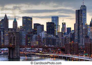New York City Skyline Lights at Sunset - NYC skyline at...