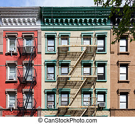 Colorful Old Apartment buildings in New York City - Colorful...
