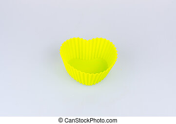 A color silicone cake form on a white background