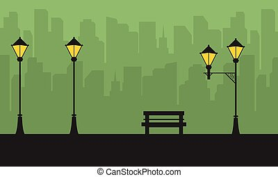 Silhouette of city with street lamp scenery