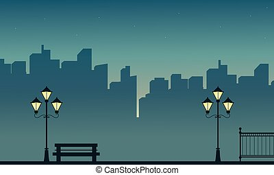 Silhouette of seat with street lamp scenery