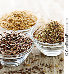 Brown and golden flax seed - Bowls of whole and ground flax...