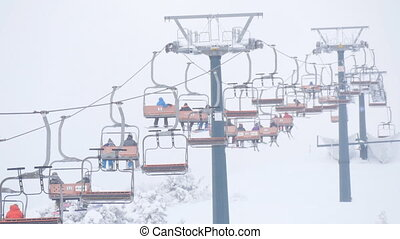 Lift at a ski resort transports skiers