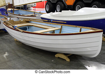White rowing boat. - Modern white rowing boat.