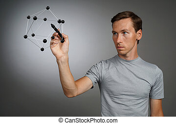 Young man works with a model of molecule. - Young man works...