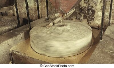 Old stone mill processing grains into flour, in Krka...