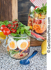 Layered salad in a jar - Layered salad with couscous in...