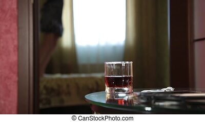 young drunk arab girl funny jumping on a bed. close-up glass...