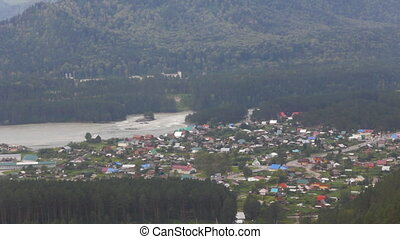 Aerial view of village in Altai mountains. house and huge...