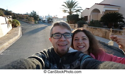 Young Couple Standing Outside Home