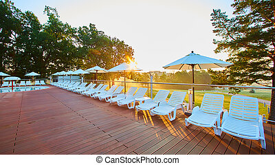 Relaxing chairs beside swimming pool