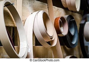 Ribbon trim chipboard on a wooden bench, furniture repair....