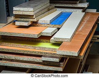 Multicolored Chipboard panels. close-up background