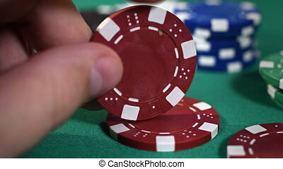 Hand Collects Poker Chips - Dealer Hand Collects Red Poker...
