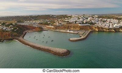 Aerial. Marina of Albufeira and the port of ships, from the...