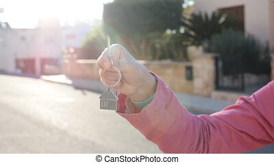 Hand holds the key to the house