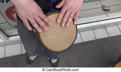 The drummer plays the drum.