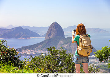 girl at the Rio de Janeiro - girl tourist taking a photo on...