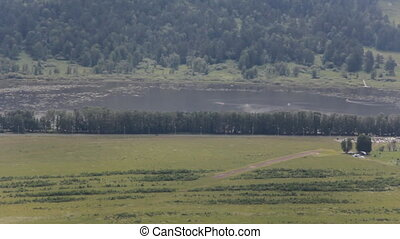 different landscape with meadow, forest, road, lake,...