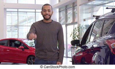 Guy holds car key in his hand - Attractive bearded guy...