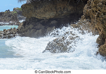 Sea water hitting stones background. Rough seas in beach...