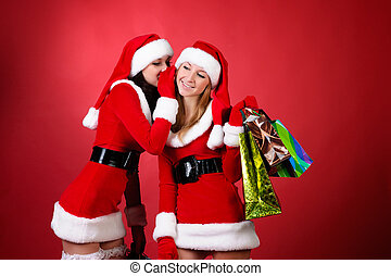 wo happy young Santa girl talking over red background