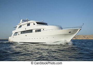 Luxury motor yacht at sea - Large private luxury motor yacht...
