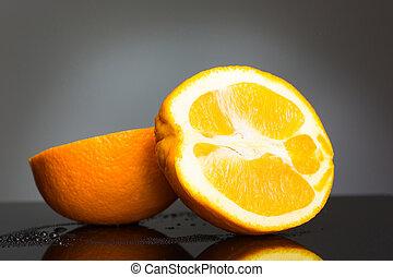 Sliced orange fruit on gray background - The orange fruit on...