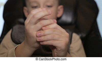 The boy kneads hands, charges for fingers - Massage for...