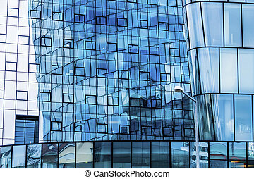 facade of an office building - the windows of a modern...