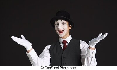 happy man mime with positive emotions on a black background.