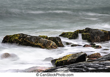 Long exposure photo of sea water running over the rocks....